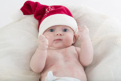 Bambino con il cappello di Santa Fotografie Stock Libere da Diritti