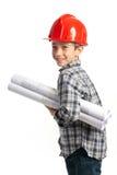 Bambino con il casco rosso e gli abbozzi Immagini Stock Libere da Diritti