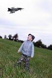 Bambino con il combattente Fotografia Stock Libera da Diritti