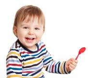 Bambino con il cucchiaio Fotografia Stock