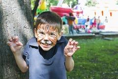 Bambino con il fronte dipinto Fotografia Stock Libera da Diritti