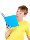 Bambino con il libro Fotografia Stock