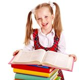 Bambino con il libro della pila. Immagine Stock