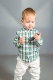 Bambino con il pettine Fotografie Stock