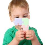 Bambino con il puzzle Fotografia Stock