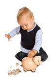 Bambino con il risparmio Fotografia Stock