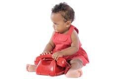 Bambino con il telefono rosso Fotografie Stock Libere da Diritti