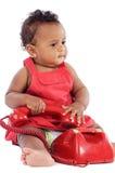 Bambino con il telefono rosso fotografia stock libera da diritti