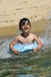 Bambino con l'anello di galleggiamento Fotografia Stock