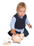 Bambino con la banca piggy Immagini Stock