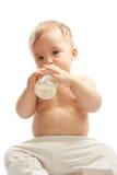 Bambino con la bottiglia per il latte Fotografie Stock Libere da Diritti