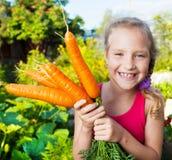 Bambino con la carota Fotografia Stock Libera da Diritti