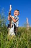 Bambino con la chitarra Fotografia Stock