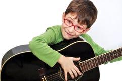 Bambino con la chitarra acustica Fotografia Stock