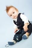 Bambino con la cuffia Fotografie Stock Libere da Diritti