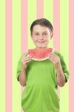 Bambino con la fetta di frutta dell'anguria Fotografia Stock Libera da Diritti