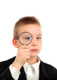Bambino con la lente d'ingrandimento Fotografia Stock