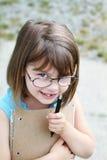 Bambino con la penna ed il libro Immagine Stock Libera da Diritti