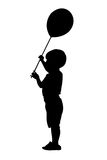 Bambino con la siluetta della sfera Immagine Stock