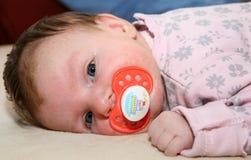 Bambino con la tettarella Immagini Stock