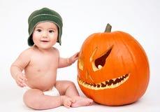 Bambino con la zucca Fotografie Stock Libere da Diritti
