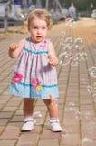 Bambino con le bolle Fotografie Stock Libere da Diritti