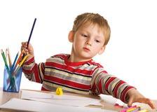 Bambino con le matite fotografie stock