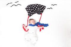 Bambino con parabrake Fotografie Stock
