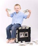 Bambino con soldi Fotografia Stock