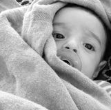 Bambino con soother Immagini Stock