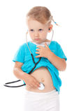 Bambino con stetoscope che gioca medico Immagini Stock