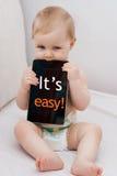 Bambino con tablet_txt_Easy Fotografia Stock