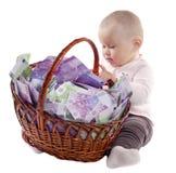 Bambino con un cestino dell'euro Immagine Stock Libera da Diritti