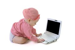 Bambino con un computer portatile Fotografia Stock