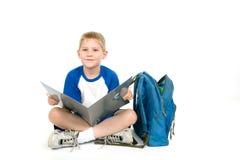 Bambino con un dispositivo di piegatura Fotografie Stock