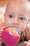 Bambino con un giocattolo Fotografia Stock