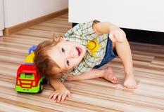 Bambino con un giocattolo Immagine Stock Libera da Diritti
