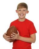 Bambino con una palla di rugby immagine stock libera da diritti