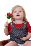 Bambino con una rosa Fotografia Stock