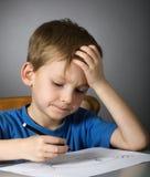 Bambino concentrato Fotografie Stock