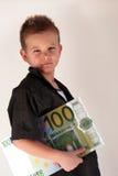 Bambino dei soldi Immagini Stock