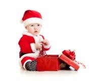 Bambino del Babbo Natale con il contenitore di regalo Immagine Stock Libera da Diritti