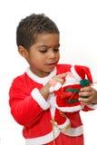 Bambino del mulatto su una priorità bassa bianca Fotografie Stock Libere da Diritti