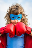Bambino del supereroe. Concetto di potere della ragazza immagini stock libere da diritti