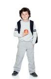 Bambino dell'allievo con lo zaino e la mela Fotografia Stock Libera da Diritti