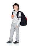 Bambino dell'allievo con lo zaino e la mela Fotografia Stock