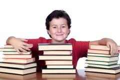 Bambino dell'allievo con molti libri Fotografie Stock