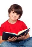 Bambino dell'allievo con un libro Immagine Stock Libera da Diritti