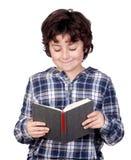 Bambino dell'allievo con un libro Fotografie Stock Libere da Diritti
