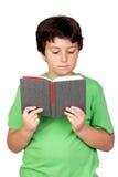 Bambino dell'allievo con un libro Immagini Stock